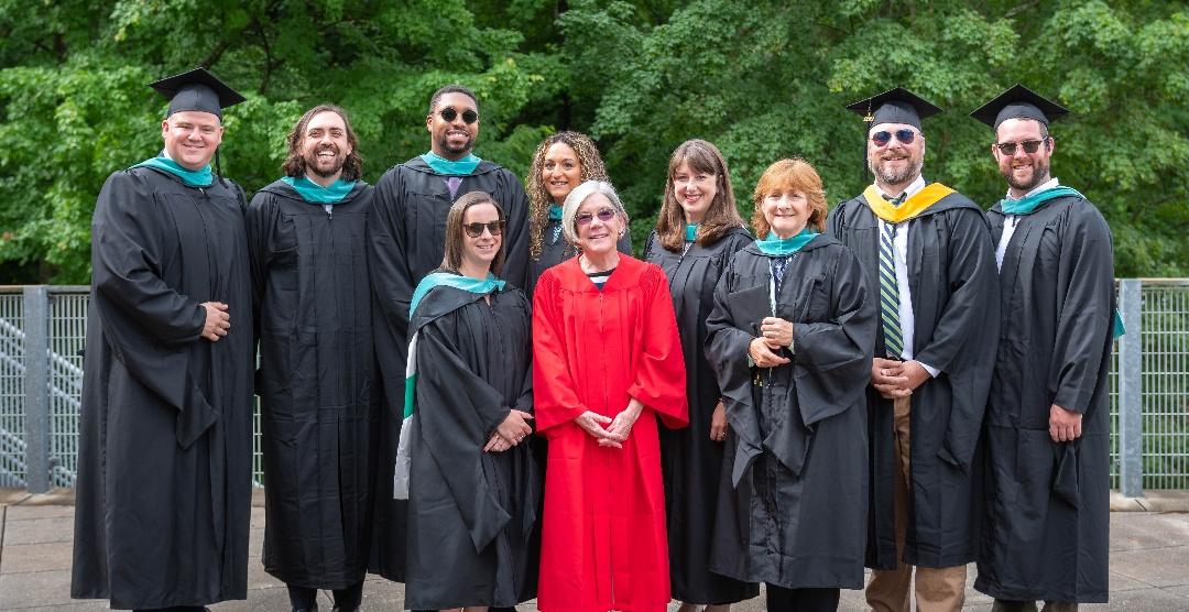 Associate Dean Mary Piecewicz with the first graduates of Clark's MPA-SL program